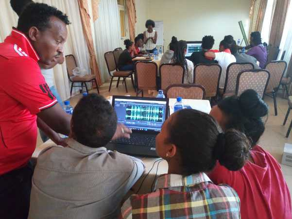 Training refugees on how to develop audio content